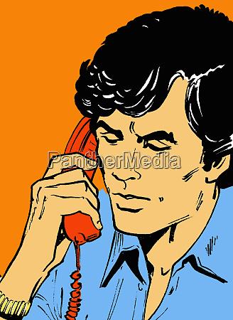 man talking on telephone