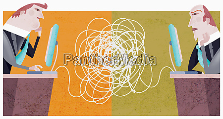 businessman with tangled computer cables