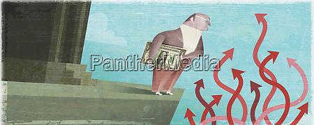 businessman holding money near tangle of