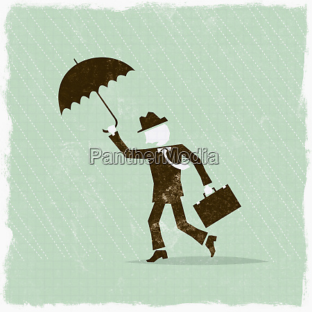 businessman with umbrella weathering the storm