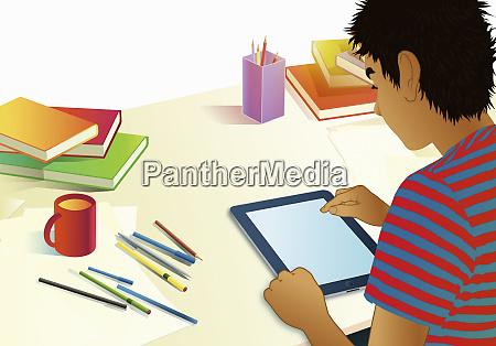 teenage boy using digital tablet for