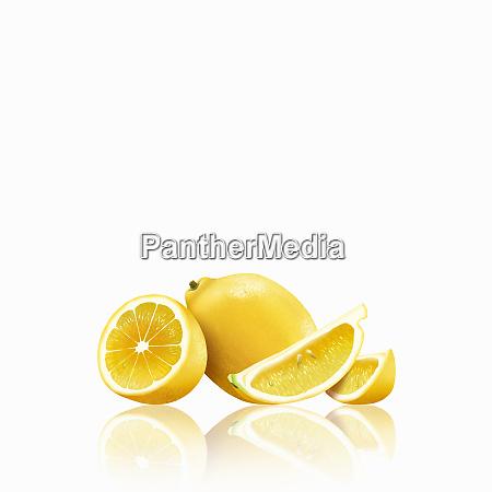 whole and cut lemons
