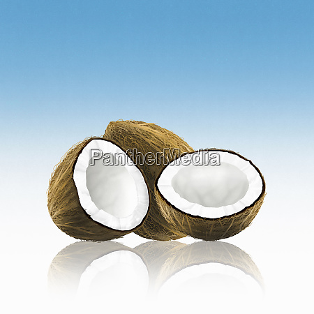 whole and halved coconut