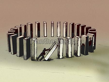 businessman collapsing circle of building blocks