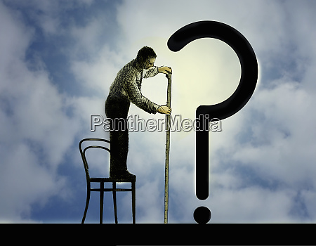 businessman standing on chair to measure