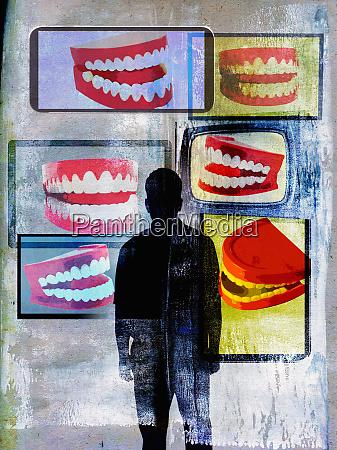 man watching fake teeth on lots