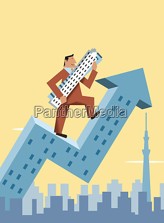 happy businessman climbing arrow skyscraper carrying