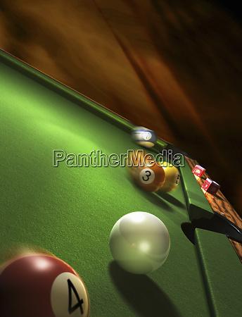 pool balls moving on pool table