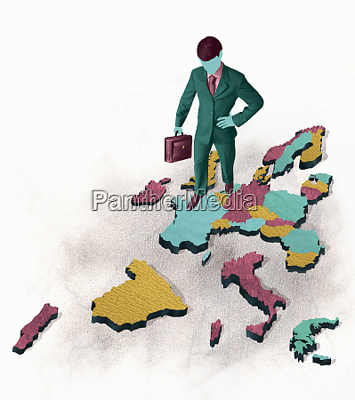businessman standing on disintegrating map of