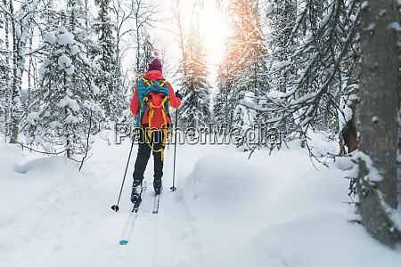 ski touring woman with skis