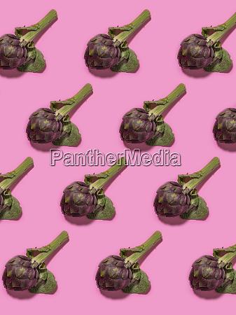 pattern of artichoke heads against pink