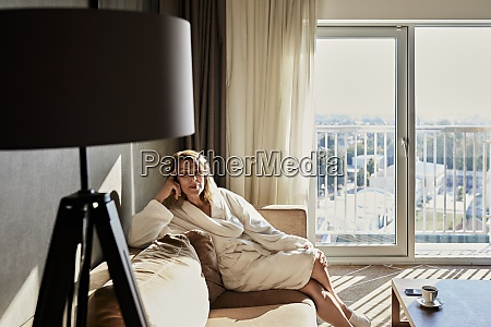 beautiful retired woman in bathrobe sitting
