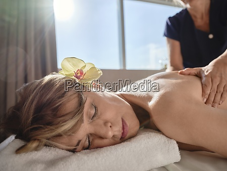 mature female giving back massage to