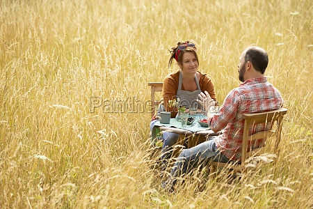couple talking and eating berries at